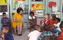 Lady bird johnson visiting a classroom for project